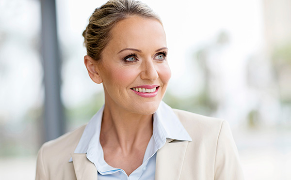 Woman smiling and looking off into the distance